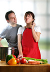 Couple in kitchen with food waste disposer